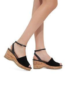 These cork embossed wedge sandals feature a wide upper strap finished in kid suede, easily elevating this summery style.