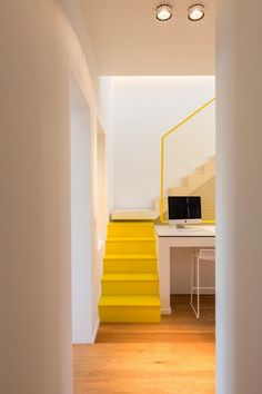 These Bright Yellow Stairs Include Hidden Spaces For Storage Loft Stairs, House Stairs, Yellow Stairs, Stair Slide, Hidden Spaces, Painted Stairs, Contemporary Apartment, Built In Desk, Stair Storage