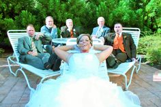 Bride with Groomsmen Smoking Cigars