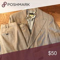 Banana Republic gray pantsuit Banana Republic gray pantsuit.  Has baby blue lining.  Size 12 jacket size 8 pants Martin fit. Banana Republic Jackets & Coats Blazers
