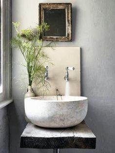 powder room sinks - bowl shaped stone vessel sink on a rustic wood slab - Cico Books via Atticmag