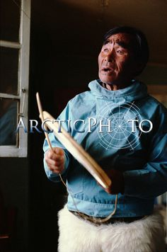 Masautsiaq Eipe an elderly Inuk drum sings using a traditional drum. Only the rim is hit. Qaanaaq, N.W. Greenland.: Qaanaaq, NW Greenland: Arctic & Antarctic photographs, pictures & images from Bryan & Cherry Alexander Photography.