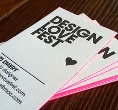 Business Cards of DesignLoveFest Blog by Bri Emery. Love the neon pink edge painting and the deep letterpress emboss.