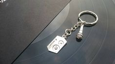 Check out this item in my Etsy shop https://www.etsy.com/uk/listing/465568488/music-lover-keyring-speaker-microphone