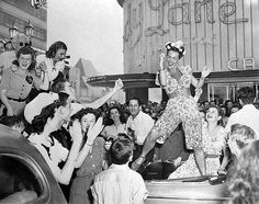Carmen Miranda dancing on top of a car at Hollywood and Vine to celebrate the end of World War II 1945
