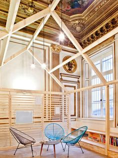 Ekimetrics, Paris: Centuries stand between the office's shell--tall ceilings, arched windows, and chandeliers--and its brand-new wooden indoor structures.