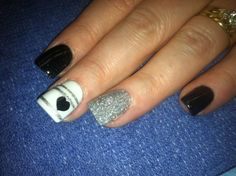 cute black nails with cute white and silver accent nails.