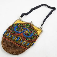 """1920's beaded evening bag from Paris with original yellow satin interior. Pristine condition. 7"""" W X 9.5"""" H"""