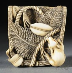 Ivory Netsuke, 19th century, study of a mouse in a winnowing basket, lg. 1 1/2 in.