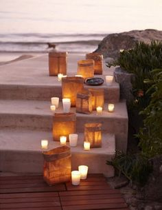 A beach wedding aisle lit with candlelight now that would be nice!
