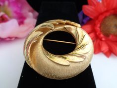Vintage Trifari Jewelry - Light Brushed Goldtone Brooch Signed Reduced to $15.00 plus free shipping to the United States. This goldtone brooch is a classic signed Trifari. You would be surprised to see all of the reductions we have made in the store.Best regards, Coco