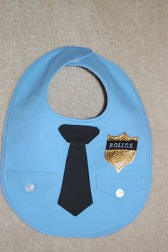 Police bib, @Kelly Teske Goldsworthy Teske Goldsworthy Teske Goldsworthy Jones @Bekah DeMieri Carroll Carroll Jones ; for Ben's future kid! haha