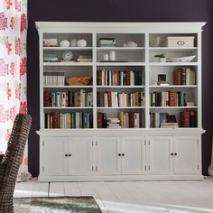 Optimize your storage and display space with the triple-bay design of this hutch unit. The molding and decorative trim are further enhanced by the semi-gloss painted finish.