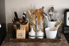 Kitchen counter organization. Put everything in one tray to move easily for cleaning