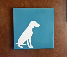 DIY Dog Silhouette: Maddie!  This tutorial is great and does not involve NEEDING a vinyl cutter- just full-sized labels, contact paper, credit card, and spray paint.  Oh, canvas and tweezers, too!  I think this would be a great gift in a small (5x7) size for a friend, or a huge one for my mom.