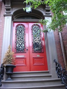 "A red door means ""welcome"".   In Feng Shui, a red door symbolizes the mouth of the home. By painting a door red (or any bright colour that stands out) chi (positive energy) is drawn to the house. It is the entry point in which abundance and opportunities find us."