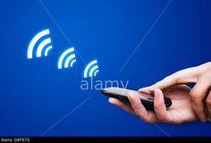 Hand holding smartphone with NFC technology - near field communication payment method. © Piotr Adamowicz / Alamy
