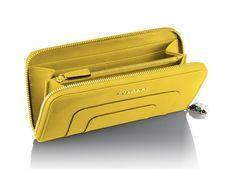 "Zipped wallet in yellow calf leather with enamel ""Serpenti"" zip puller by Bulgari"