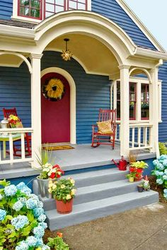 A five-color paint scheme plays up architectural detail. | thisoldhouse.com #homes #exteriors -- enjamin Moore's Raisin Torte for the prized door and the window sashes, and Van Deusen Blue on the body. For the trim, they went with Sherwin-Williams's Tea Light. A local paint manufacturer supplied the flagstone hue for the porch floor and the yellow-gold for its ceiling