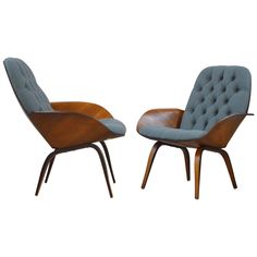 Pair of Plywood Mulhauser Lounge Chairs by Plycraft | From a unique collection of antique and modern lounge chairs at https://www.1stdibs.com/furniture/seating/lounge-chairs/