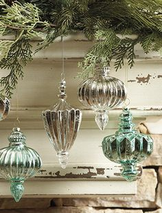 Hang ornaments from garland on mantel