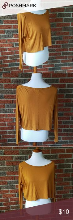 Mustard Long Sleeve Crop Top A gently worn mustard colored long sleeve crop top size small. Has a loose fit. No damage or worn spots. I only wore it once. Pairs great with leggings. Forever 21 Tops Crop Tops