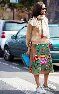 Viviana Volpicella wearing a Valentino skirt with sneakers