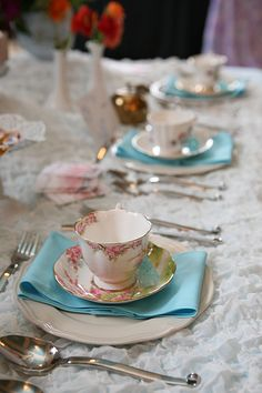 Tea Party TABLE SETTING: White Textured Tablecloth + Pink Floral Teacups + PLACED on Aqua Napkins.