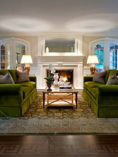 Two facing moss green velvet couches from Robert Allen, NY