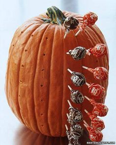 Drill holes in pumpkin to make it hold suckers for halloween