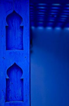 Deep cobalt blue niches in a wall