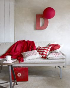 Red accents are perfect for warming up a neutral space, giving it that extra bit of character.