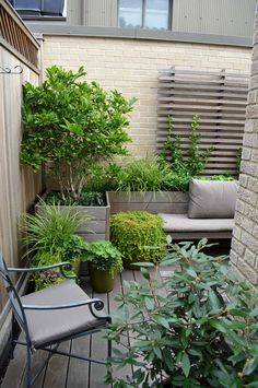 Traditional Porch (but in the sky) on a CPW New York City balcony - Every square foot has been put to good use, w/ built-in planters and benches wrapping around the tight corner. A restrained palette of weathered wood & green is simple and elegant -- by Jeffrey Erb Landscape Design