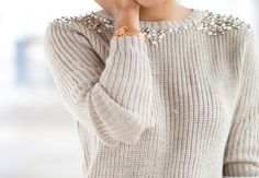 embellish a fisherman sweater with pearls and silver beads.