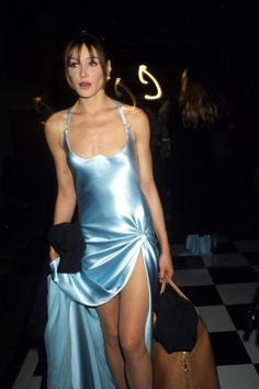 Nineties nostalgia! Carla Bruni attends the Versace High Fashion Show at the Ritz Paris on January 13,1995.