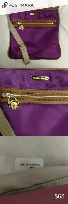 Michael Kors purple nylon crossbody Great condition, very lightly used. Outside is nylon. Has a few pockets inside and one zipper pocket inside and one zipper pocket outside. Had adjustable strap.  Ask any questions. Michael Kors Bags Crossbody Bags