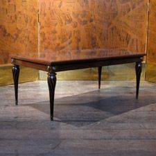 A good quality, mid 20th century French mahogany and ebonised coffee table.