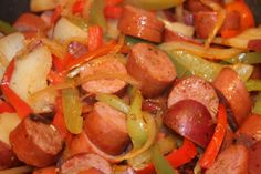 Sausage with peppers, onions and potatoes - I just made this last night and I ADD A CAN OF TOMATOES to this with some spices to kick it up a bit!