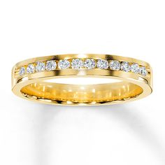 """This year, tell her """"I forever do"""" with this brilliant diamond anniversary band, featuring a total diamond weight of 1/4 carat. A dozen near-colorless round diamonds, hand-selected to match beautifully, are set in 14K yellow gold in this fine jewelry band."""