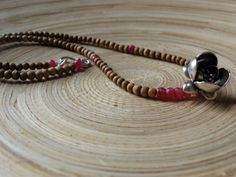 Lotus necklace with Hill Tribe fine silver hanging lotus pendant, rubies & sandalwood