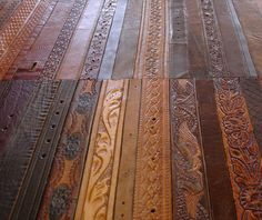 Flooring made from leather belts. I would love this so much more than hardwood. Not with pets though.