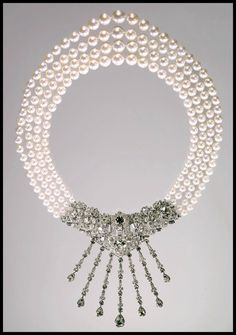 Marjorie Merriweather Post's incredible three strand Caro Yamaoka pearl and diamond necklace, circa 1963 is meant to be worn with the dazzling diamonds cascading down the nape of the wearer's neck while the pearls hang down in front. Both the details and the diamonds of the Cartier clasp are exquisite.