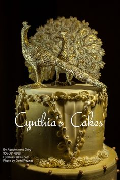 An incredible pair of loving peacocks top off this vintage style wedding cake designed by Cynthia Ebrom of Cynthia's Cakes-Edinburg, Tx. http://cynthiascakes.com