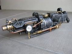 Nerf Vulcan Custom - THE GOLIATHON. This steampunk custom copper-and-brass hand cannon will send your dastardly foes running for the dens of villainy from whence they sprung $350