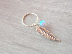 Tribal feather cartilage earring piercing by sofisjewelryshop