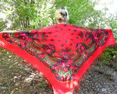 This beautiful vintage large shawl dates back approximately to 1990's and comes from Ukraine. Its design features a beautiful floral pattern on red background.Traditional slavic floral design.