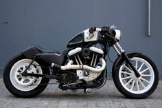 Harley-Davidson Sportster Evolution... cool colors and stance. not so cool rear suspension, can you imagine trying to drift this thing with that back end rattling around!