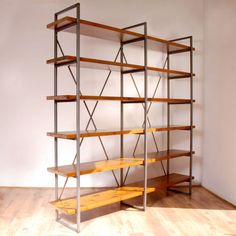 Large Industrial Vintage Rustic Solid Wood & Steel Free Standing Shelves Bookcase constructed from 6 solid 30mm thick pine shelves fastened to two steel ladder frames. The ladders are fastened by two solid steel straps securely bolted into the frame. Stainless steel hardware is