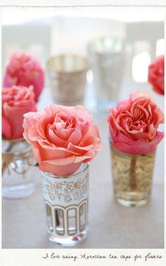 I spy a wedding trend blooming on Pinterest - Moroccan tea glases for flowers & decorations at your wedding venue.  This beautiful image is from the ever inspiring A Creative Mint blog.