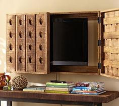"Hide that unsightly TV with the Riddling Rack Media Solution (downside is it only covers up to a 56"" TV...I don't know about you, but that's a little TV by our standards #potterybarn"